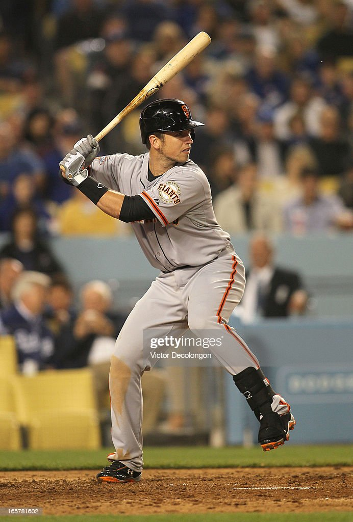 Buster Posey #28 of the San Francisco Giants bats in the sixth inning during the MLB game against the Los Angeles Dodgers at Dodger Stadium on April 3, 2013 in Los Angeles, California. The Giants defeated the Dodgers 5-3.