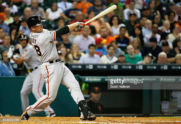 Buster Posey of the San Francisco Giants belts a tworun home run in the fifth inning of their game against the Houston Astros at Minute Maid Park on...