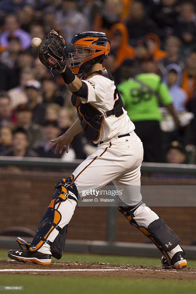 <a gi-track='captionPersonalityLinkClicked' href=/galleries/search?phrase=Buster+Posey&family=editorial&specificpeople=4896435 ng-click='$event.stopPropagation()'>Buster Posey</a> #28 of the San Francisco Giants catches a ball at home plate to force out Adam LaRoche (not pictured) of the Washington Nationals during the fourth inning at AT&T Park on May 21, 2013 in San Francisco, California. The San Francisco Giants defeated the Washington Nationals 4-2 in 10 innings.