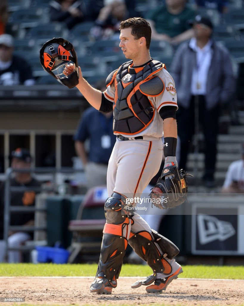 Buster Posey #28 of the San Francisco Giants catches against the Chicago White Sox on September 10, 2017 at Guaranteed Rate Field in Chicago, Illinois. The White Sox defeated the Giants 8-1.