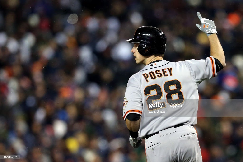 <a gi-track='captionPersonalityLinkClicked' href=/galleries/search?phrase=Buster+Posey&family=editorial&specificpeople=4896435 ng-click='$event.stopPropagation()'>Buster Posey</a> #28 of the San Francisco Giants celebrates after scoring a two run home run to left field against Max Scherzer #37 of the Detroit Tigers in the sixth inning during Game Four of the Major League Baseball World Series at Comerica Park on October 28, 2012 in Detroit, Michigan.