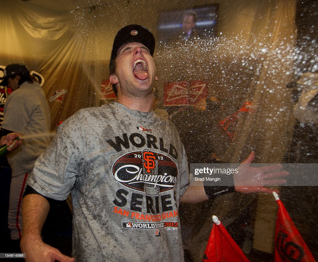 Buster Posey of the San Francisco Giants celebrates in the clubhouse after the Giants defeat the Detroit Tigers to win the 2012 World Series on Sunday, October 28, 2012 at Comerica Park in Detroit, Michigan.