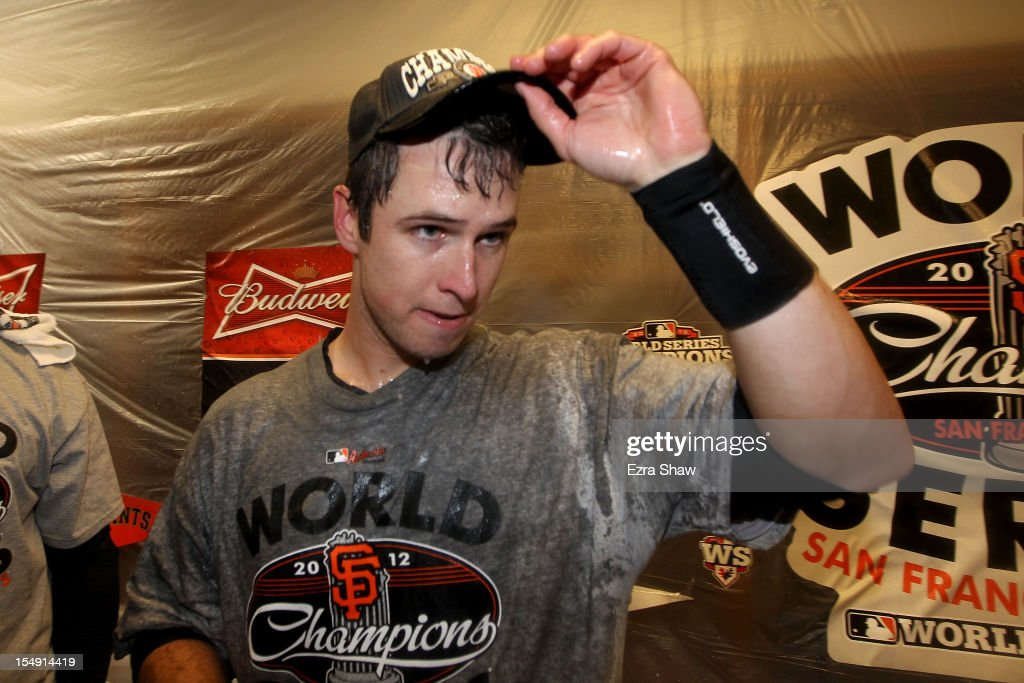 <a gi-track='captionPersonalityLinkClicked' href=/galleries/search?phrase=Buster+Posey&family=editorial&specificpeople=4896435 ng-click='$event.stopPropagation()'>Buster Posey</a> #28 of the San Francisco Giants celebrates in the locker room after defeating the Detroit Tigers to win Game Four of the Major League Baseball World Series at Comerica Park on October 28, 2012 in Detroit, Michigan. The San Francisco Giants defeated the Detroit Tigers 4-3 in the tenth inning to win the World Series in 4 straight games.