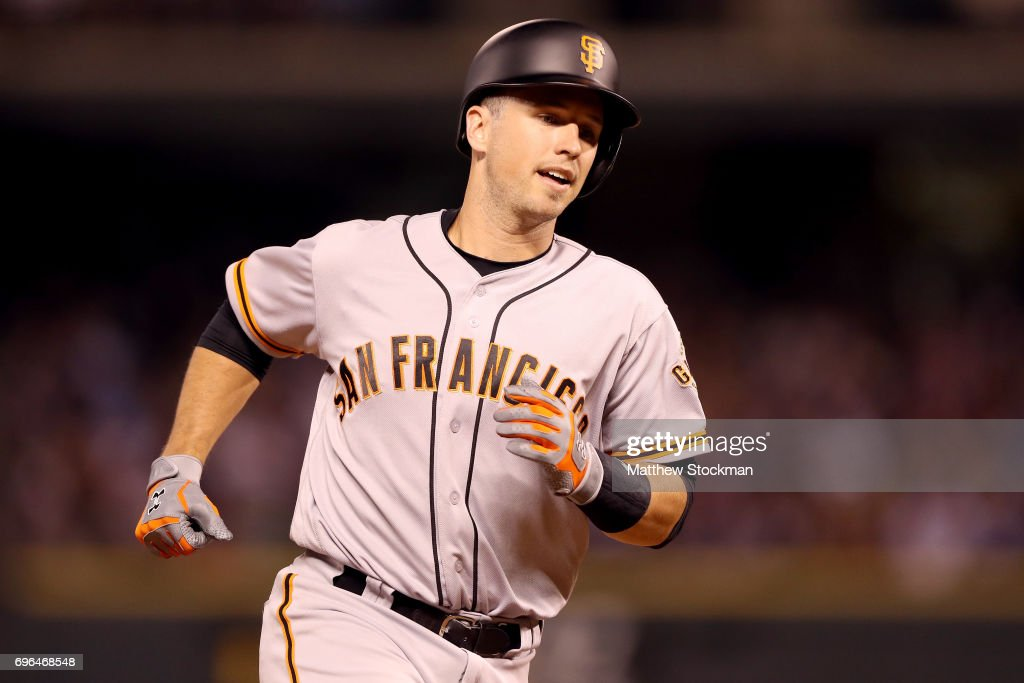 Buster Posey #28 of the San Francisco Giants circles the bases after hitting a 2 RBI home run in the seventh inning against the Coloarado Rockies at Coors Field on June 15, 2017 in Denver, Colorado.