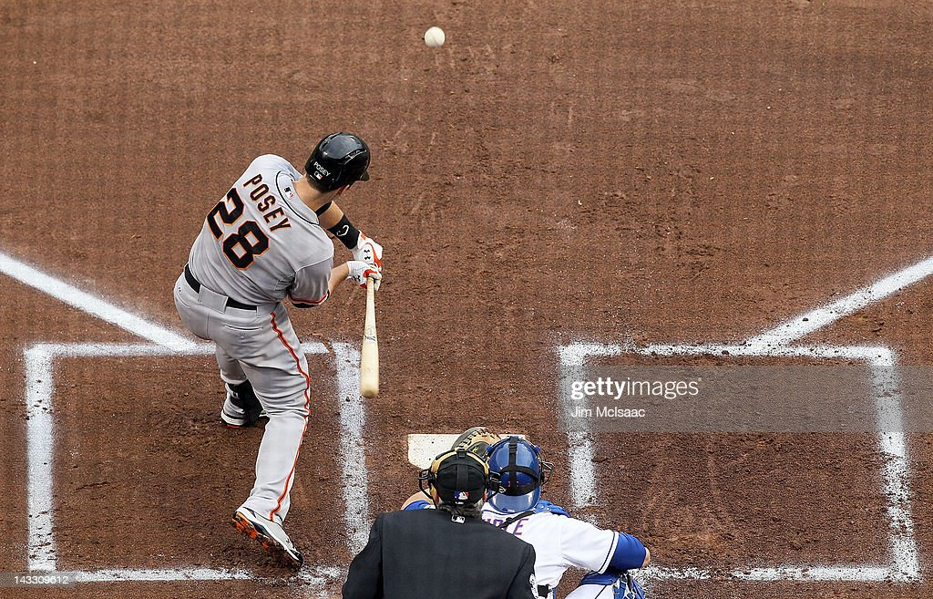 <a gi-track='captionPersonalityLinkClicked' href=/galleries/search?phrase=Buster+Posey&family=editorial&specificpeople=4896435 ng-click='$event.stopPropagation()'>Buster Posey</a> #28 of the San Francisco Giants connects on a first inning home run against the New York Mets at Citi Field on April 23, 2012 in the Flushing neighborhood of the Queens borough of New York City.