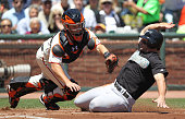 Buster Posey of the San Francisco Giants fails to tag our Dan Uggla of the Florida Marlins on a double hit by Mike Stanton in the second inning...