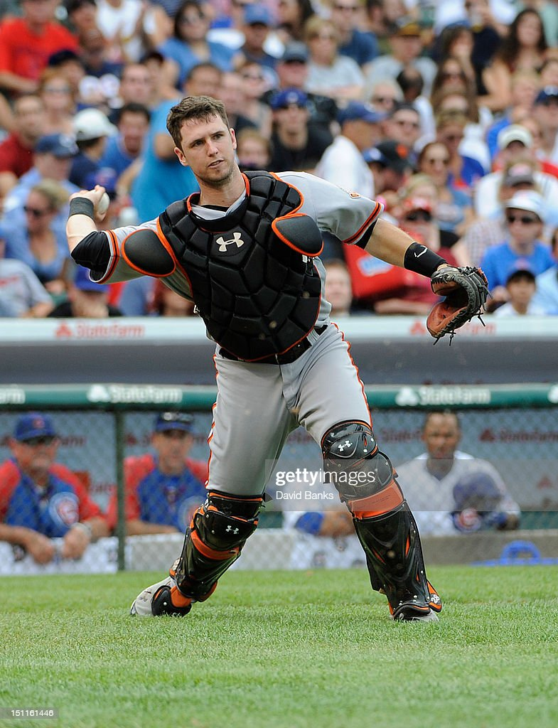 <a gi-track='captionPersonalityLinkClicked' href=/galleries/search?phrase=Buster+Posey&family=editorial&specificpeople=4896435 ng-click='$event.stopPropagation()'>Buster Posey</a> #28 of the San Francisco Giants fields a bunt against the Chicago Cubs in the fifth innig on September 02 2012 at Wrigley Field in Chicago, Illinois.