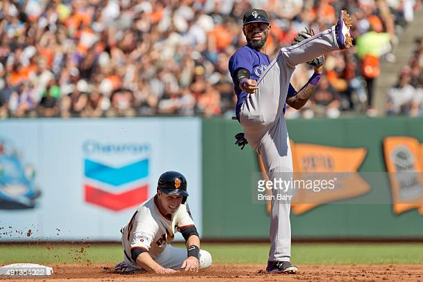 Buster Posey of the San Francisco Giants gets caught in a fielders choice by shortstop Jose Reyes of the Colorado Rockies in the first inning at ATT...