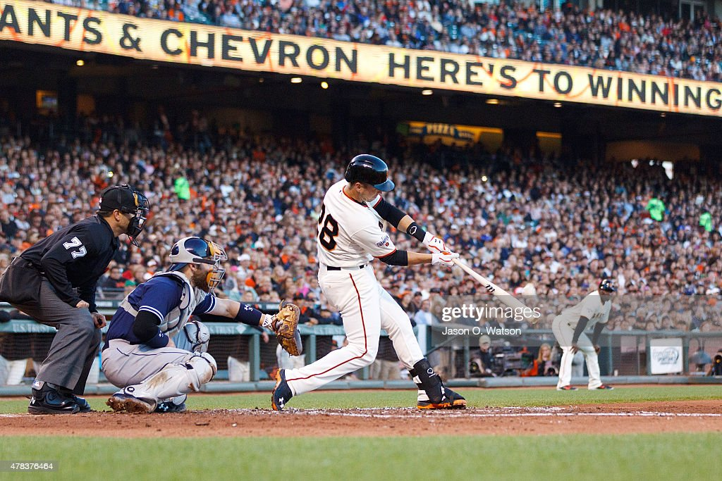 <a gi-track='captionPersonalityLinkClicked' href=/galleries/search?phrase=Buster+Posey&family=editorial&specificpeople=4896435 ng-click='$event.stopPropagation()'>Buster Posey</a> #28 of the San Francisco Giants hits a grand slam home run against the San Diego Padres during the third inning at AT&T Park on June 24, 2015 in San Francisco, California.
