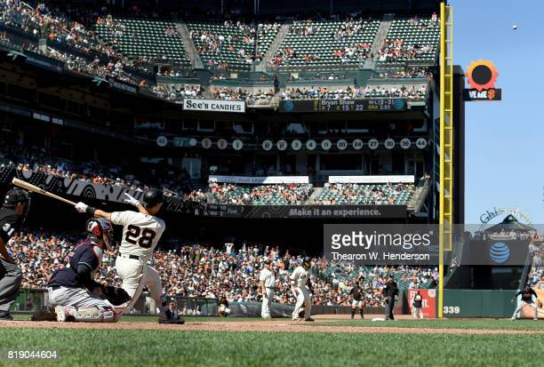 Buster Posey of the San Francisco Giants hits a pitchhit tworun rbi double against the Cleveland Indians in the bottom of the eighth inning at ATT...