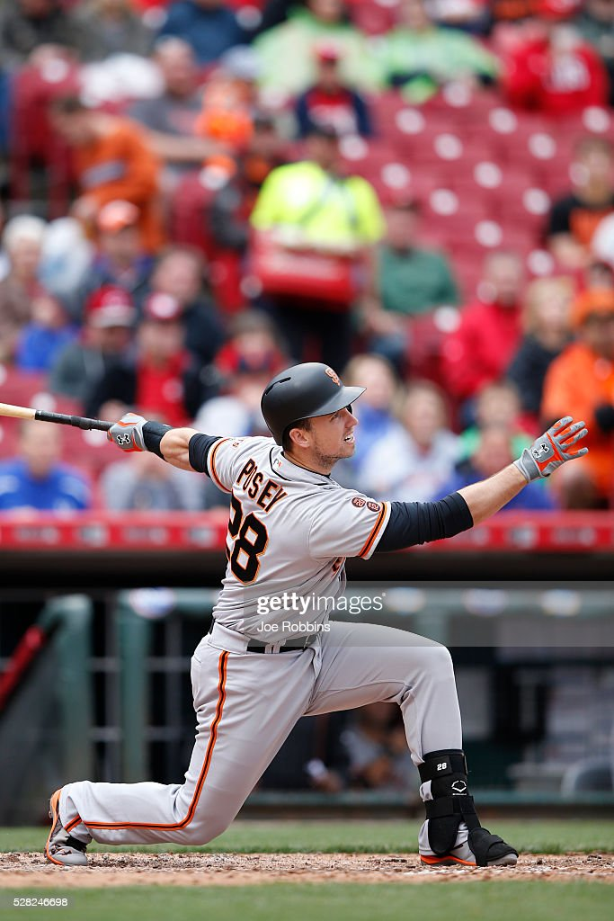 <a gi-track='captionPersonalityLinkClicked' href=/galleries/search?phrase=Buster+Posey&family=editorial&specificpeople=4896435 ng-click='$event.stopPropagation()'>Buster Posey</a> #28 of the San Francisco Giants hits a sacrifice fly to drive in a run against the Cincinnati Reds in the seventh inning of the game at Great American Ball Park on May 4, 2016 in Cincinnati, Ohio. The Reds defeated the Giants 7-4.