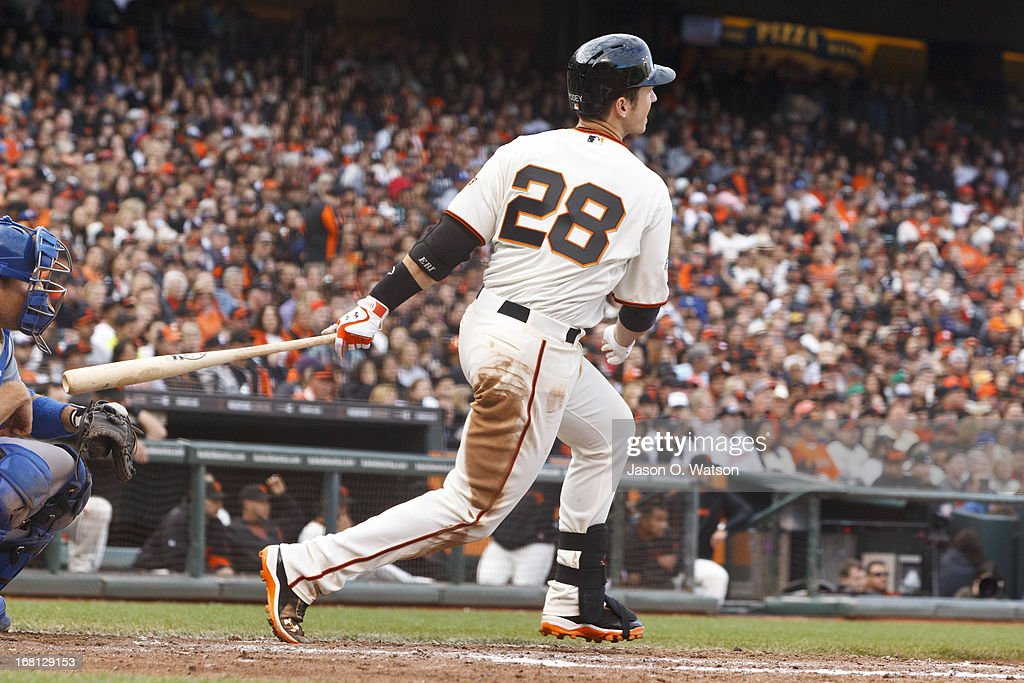 <a gi-track='captionPersonalityLinkClicked' href=/galleries/search?phrase=Buster+Posey&family=editorial&specificpeople=4896435 ng-click='$event.stopPropagation()'>Buster Posey</a> #28 of the San Francisco Giants hits a single against the Los Angeles Dodgers during the fifth inning at AT&T Park on May 5, 2013 in San Francisco, California.