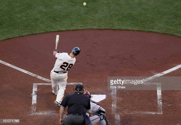 Buster Posey of the San Francisco Giants hits a single in his first game of the season at bat that scored Freddy Sanchez to give the Giants a 20 lead...