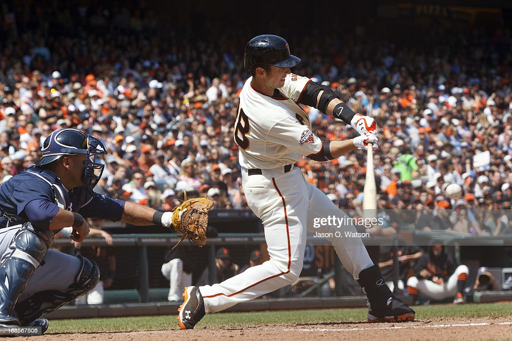 <a gi-track='captionPersonalityLinkClicked' href=/galleries/search?phrase=Buster+Posey&family=editorial&specificpeople=4896435 ng-click='$event.stopPropagation()'>Buster Posey</a> #28 of the San Francisco Giants hits an RBI double against the Atlanta Braves during the fifth inning at AT&T Park on May 11, 2013 in San Francisco, California.