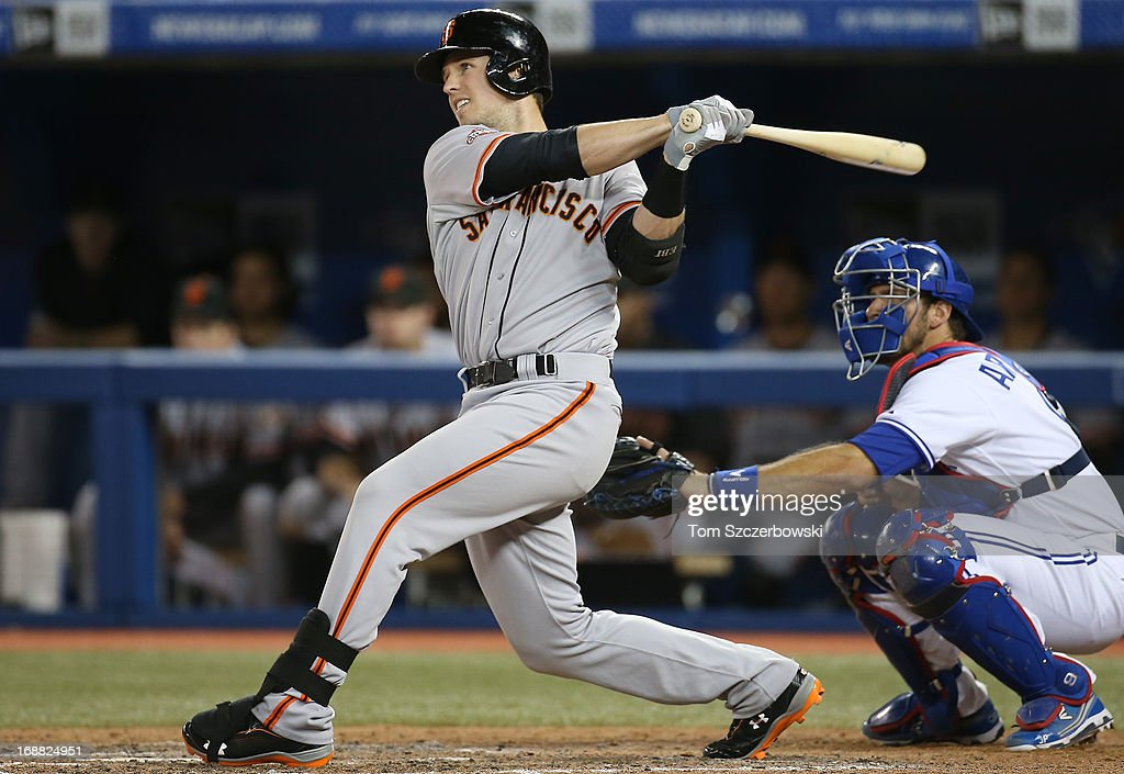 <a gi-track='captionPersonalityLinkClicked' href=/galleries/search?phrase=Buster+Posey&family=editorial&specificpeople=4896435 ng-click='$event.stopPropagation()'>Buster Posey</a> #28 of the San Francisco Giants hits an RBI double in the eighth inning during MLB game action against the Toronto Blue Jays on May 15, 2013 at Rogers Centre in Toronto, Ontario, Canada.