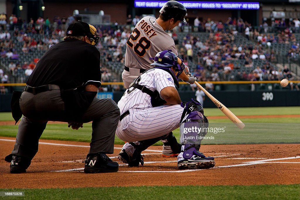<a gi-track='captionPersonalityLinkClicked' href=/galleries/search?phrase=Buster+Posey&family=editorial&specificpeople=4896435 ng-click='$event.stopPropagation()'>Buster Posey</a> #28 of the San Francisco Giants hits an RBI sacrifice-fly during the first inning against the Colorado Rockies at Coors Field on May 17, 2013 in Denver, Colorado.
