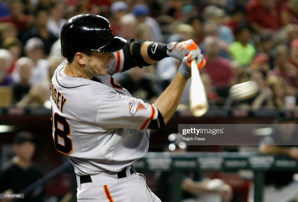 <a gi-track='captionPersonalityLinkClicked' href=/galleries/search?phrase=Buster+Posey&family=editorial&specificpeople=4896435 ng-click='$event.stopPropagation()'>Buster Posey</a> #28 of the San Francisco Giants hits an RBI single against the Arizona Diamondbacks during the seventh inning of a MLB game at Chase Field on August 31, 2013 in Phoenix, Arizona.