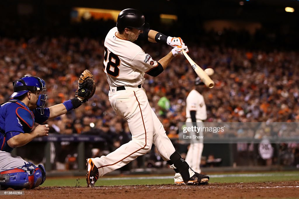 Buster Posey #28 of the San Francisco Giants hits an RBI single in the third inning during Game Three of their National League Division Series against the Chicago Cubs at AT&T Park on October 10, 2016 in San Francisco, California.