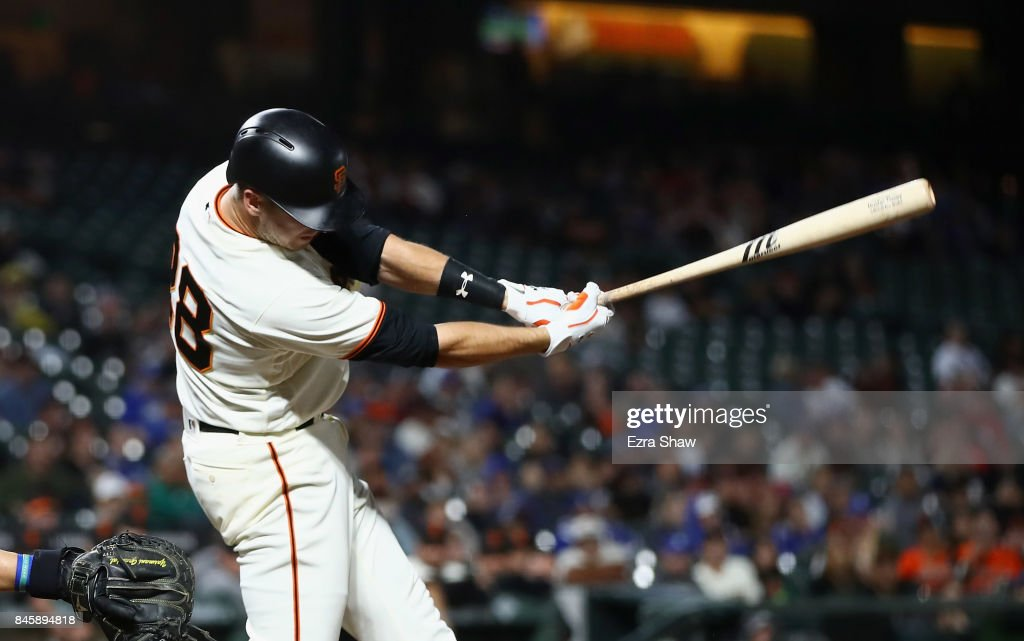 Buster Posey #28 of the San Francisco Giants hits an RBI single in the fifth inning against the Los Angeles Dodgers at AT&T Park on September 11, 2017 in San Francisco, California.