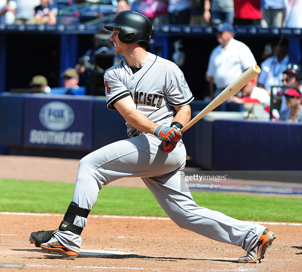 <a gi-track='captionPersonalityLinkClicked' href=/galleries/search?phrase=Buster+Posey&family=editorial&specificpeople=4896435 ng-click='$event.stopPropagation()'>Buster Posey</a> #28 of the San Francisco Giants hits during and gets on base by error the ninth inning against the Atlanta Braves at Turner Field on May 30, 2016 in Atlanta, Georgia.