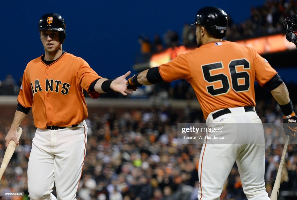 <a gi-track='captionPersonalityLinkClicked' href=/galleries/search?phrase=Buster+Posey&family=editorial&specificpeople=4896435 ng-click='$event.stopPropagation()'>Buster Posey</a> #28 of the San Francisco Giants is congratulated by <a gi-track='captionPersonalityLinkClicked' href=/galleries/search?phrase=Andres+Torres&family=editorial&specificpeople=835839 ng-click='$event.stopPropagation()'>Andres Torres</a> #56 after Posey scored against the Atlanta Braves in the fourth inning at AT&T Park on May 10, 2013 in San Francisco, California. Posey scored on an RBI double from Brandon Belt.