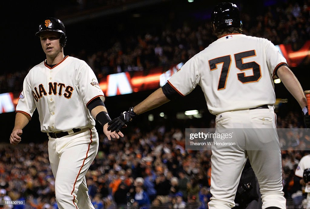 <a gi-track='captionPersonalityLinkClicked' href=/galleries/search?phrase=Buster+Posey&family=editorial&specificpeople=4896435 ng-click='$event.stopPropagation()'>Buster Posey</a> #28 of the San Francisco Giants is congratulated by <a gi-track='captionPersonalityLinkClicked' href=/galleries/search?phrase=Barry+Zito&family=editorial&specificpeople=202943 ng-click='$event.stopPropagation()'>Barry Zito</a> #75 after Posey scored during the second inning against the Los Angeles Dodgers at AT&T Park on September 25, 2013 in San Francisco, California. Posey scored on a bases loaded triple from Tony Abreu.