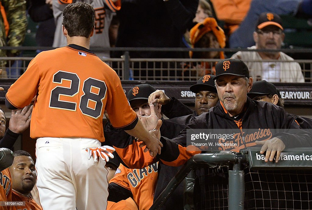 <a gi-track='captionPersonalityLinkClicked' href=/galleries/search?phrase=Buster+Posey&family=editorial&specificpeople=4896435 ng-click='$event.stopPropagation()'>Buster Posey</a> #28 of the San Francisco Giants is congratulated by manager <a gi-track='captionPersonalityLinkClicked' href=/galleries/search?phrase=Bruce+Bochy&family=editorial&specificpeople=220291 ng-click='$event.stopPropagation()'>Bruce Bochy</a> (R) after Posey scored against the San Diego Padres in the third inning at AT&T Park on April 19, 2013 in San Francisco, California.