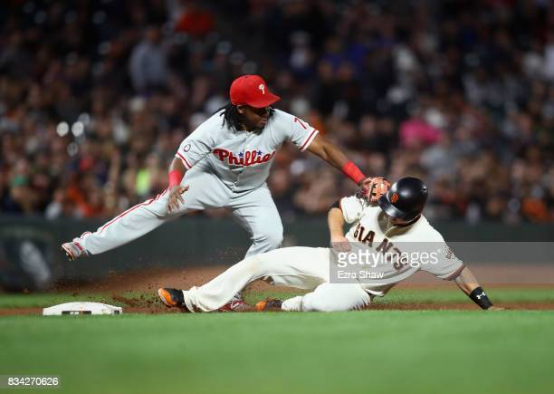 Buster Posey of the San Francisco Giants is taggged out by Maikel Franco of the Philadelphia Phillies at third base in the fifth inning at ATT Park...