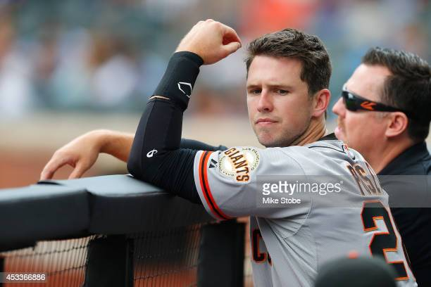 Buster Posey of the San Francisco Giants looks on against the New York Mets at Citi Field on August 4 2014 in the Flushing neighborhood of the Queens...