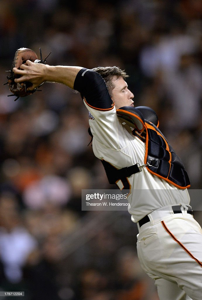 <a gi-track='captionPersonalityLinkClicked' href=/galleries/search?phrase=Buster+Posey&family=editorial&specificpeople=4896435 ng-click='$event.stopPropagation()'>Buster Posey</a> #28 of the San Francisco Giants reaches back over his head to catch a foul pop-up off the bat of Caleb Gindl #15 of the Milwaukee Brewers in the seventh inning at AT&T Park on August 6, 2013 in San Francisco, California.