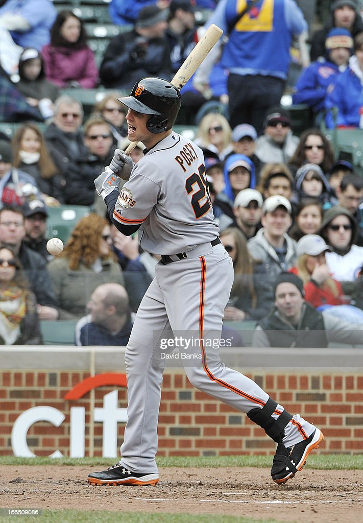 <a gi-track='captionPersonalityLinkClicked' href=/galleries/search?phrase=Buster+Posey&family=editorial&specificpeople=4896435 ng-click='$event.stopPropagation()'>Buster Posey</a> #28 of the San Francisco Giants reacts after being hit by a pitch against the Chicago Cubs during the sixth inning on April 13, 2013 at Wrigley Field in Chicago, Illinois.