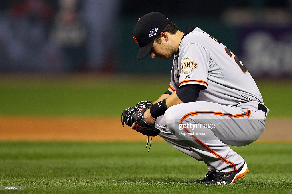 <a gi-track='captionPersonalityLinkClicked' href=/galleries/search?phrase=Buster+Posey&family=editorial&specificpeople=4896435 ng-click='$event.stopPropagation()'>Buster Posey</a> #28 of the San Francisco Giants reacts in the eighth inning while taking on the St. Louis Cardinals in Game Four of the National League Championship Series at Busch Stadium on October 18, 2012 in St Louis, Missouri.