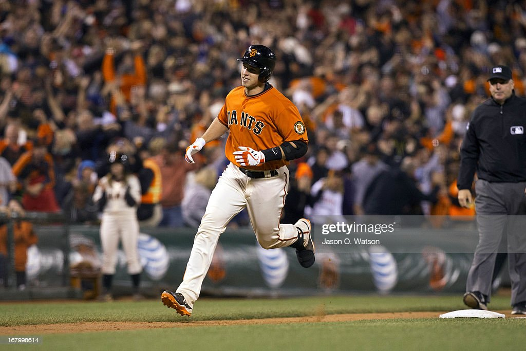 <a gi-track='captionPersonalityLinkClicked' href=/galleries/search?phrase=Buster+Posey&family=editorial&specificpeople=4896435 ng-click='$event.stopPropagation()'>Buster Posey</a> #28 of the San Francisco Giants rounds the bases after hitting a walk-off home run off of Ronald Belisario (not pictured) of the Los Angeles Dodgers in the ninth inning at AT&T Park on May 3, 2013 in San Francisco, California. The San Francisco Giants defeated the Los Angeles Dodgers 2-1.
