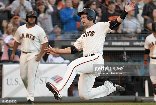 Buster Posey of the San Francisco Giants scores against the Arizona Diamondbacks in the bottom of the seventh inning at ATT Park on July 10 2016 in...