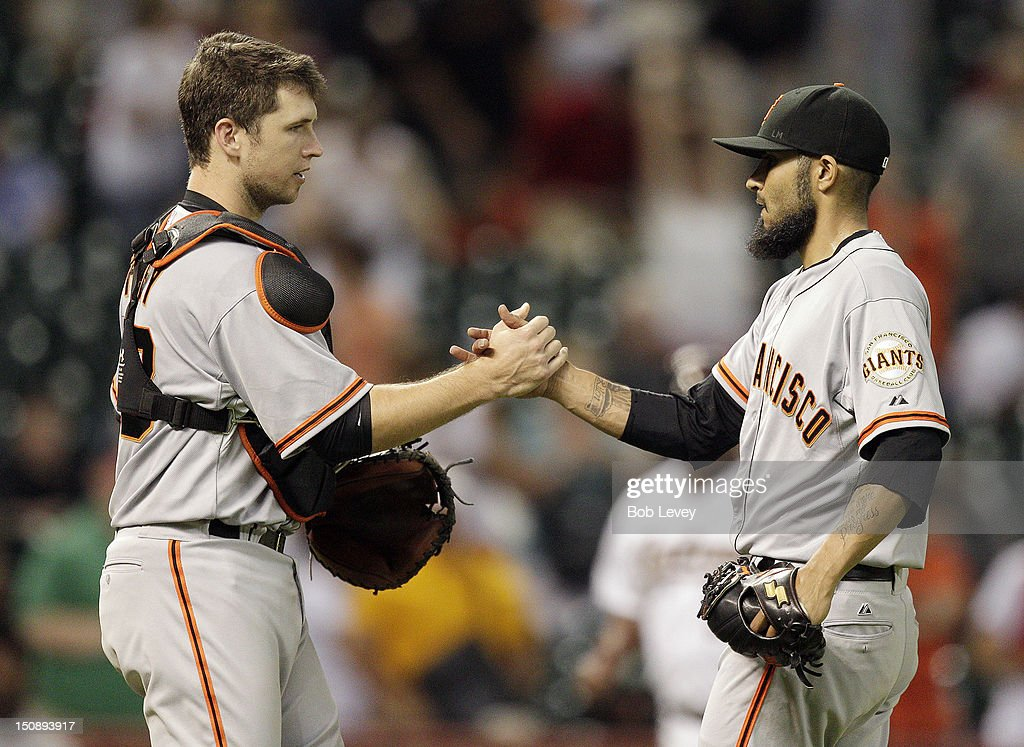 <a gi-track='captionPersonalityLinkClicked' href=/galleries/search?phrase=Buster+Posey&family=editorial&specificpeople=4896435 ng-click='$event.stopPropagation()'>Buster Posey</a> #28 of the San Francisco Giants shakes hands with pitcher <a gi-track='captionPersonalityLinkClicked' href=/galleries/search?phrase=Sergio+Romo&family=editorial&specificpeople=5433590 ng-click='$event.stopPropagation()'>Sergio Romo</a> #54 after defeating the Houston Astros 3-2 at Minute Maid Park on August 28, 2012 in Houston, Texas.