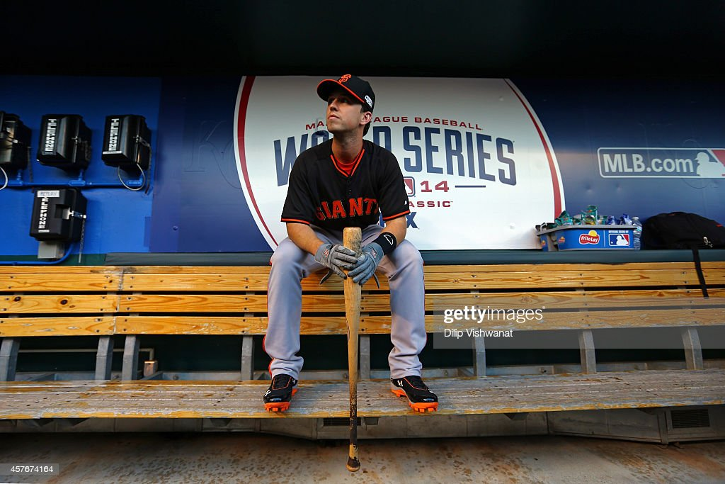 <a gi-track='captionPersonalityLinkClicked' href=/galleries/search?phrase=Buster+Posey&family=editorial&specificpeople=4896435 ng-click='$event.stopPropagation()'>Buster Posey</a> #28 of the San Francisco Giants sits in the dugout during batting practice prior to Game Two of the 2014 World Series against the Kansas City Royals at Kauffman Stadium on October 22, 2014 in Kansas City, Missouri.