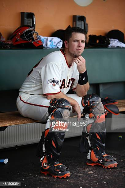 Buster Posey of the San Francisco Giants sits in the dugout during the game against the Washington Nationals at ATT Park on Sunday August 16 2015 in...