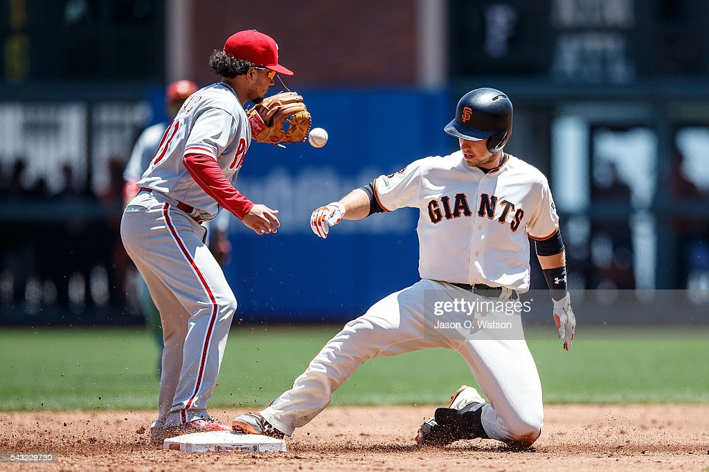 <a gi-track='captionPersonalityLinkClicked' href=/galleries/search?phrase=Buster+Posey&family=editorial&specificpeople=4896435 ng-click='$event.stopPropagation()'>Buster Posey</a> #28 of the San Francisco Giants slides into second ahead of a throw to <a gi-track='captionPersonalityLinkClicked' href=/galleries/search?phrase=Freddy+Galvis&family=editorial&specificpeople=6772271 ng-click='$event.stopPropagation()'>Freddy Galvis</a> #13 of the Philadelphia Phillies during the third inning at AT&T Park on June 26, 2016 in San Francisco, California. The San Francisco Giants defeated the Philadelphia Phillies 8-7.