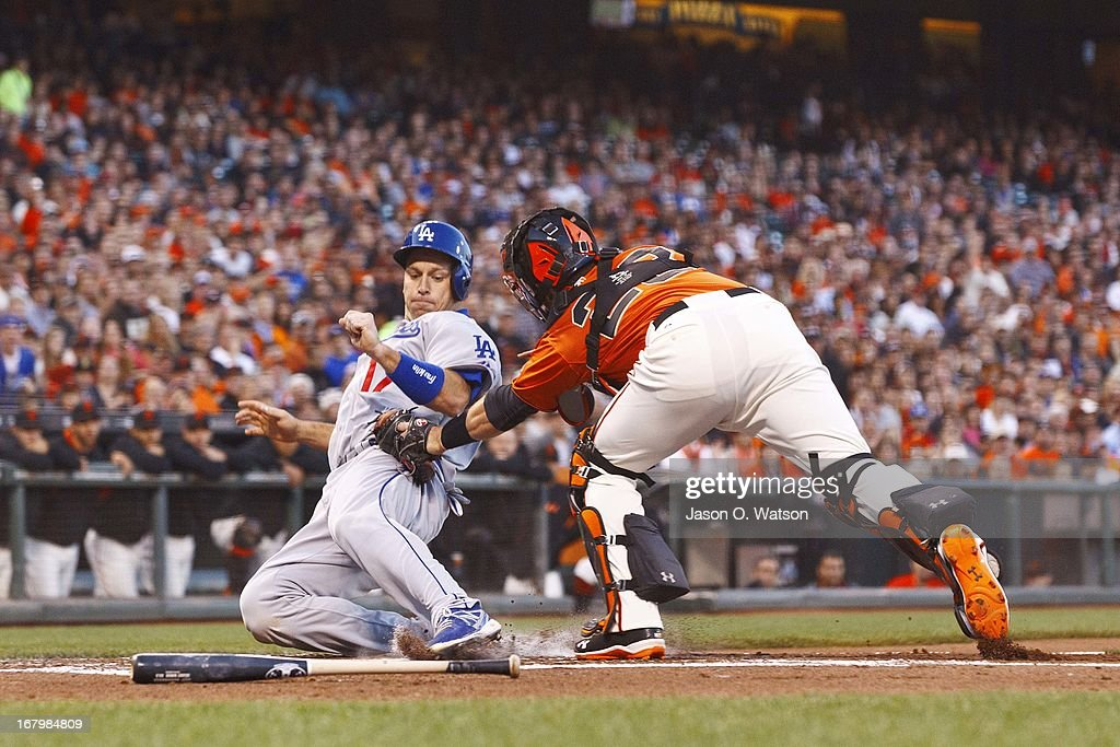<a gi-track='captionPersonalityLinkClicked' href=/galleries/search?phrase=Buster+Posey&family=editorial&specificpeople=4896435 ng-click='$event.stopPropagation()'>Buster Posey</a> #28 of the San Francisco Giants tags out A.J. Ellis #17 of the Los Angeles Dodgers at home plate during the second inning at AT&T Park on May 3, 2013 in San Francisco, California.