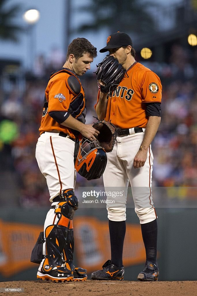 <a gi-track='captionPersonalityLinkClicked' href=/galleries/search?phrase=Buster+Posey&family=editorial&specificpeople=4896435 ng-click='$event.stopPropagation()'>Buster Posey</a> #28 of the San Francisco Giants talks to <a gi-track='captionPersonalityLinkClicked' href=/galleries/search?phrase=Barry+Zito&family=editorial&specificpeople=202943 ng-click='$event.stopPropagation()'>Barry Zito</a> #75 on the pitchers mound against the Los Angeles Dodgers during the third inning at AT&T Park on May 3, 2013 in San Francisco, California.