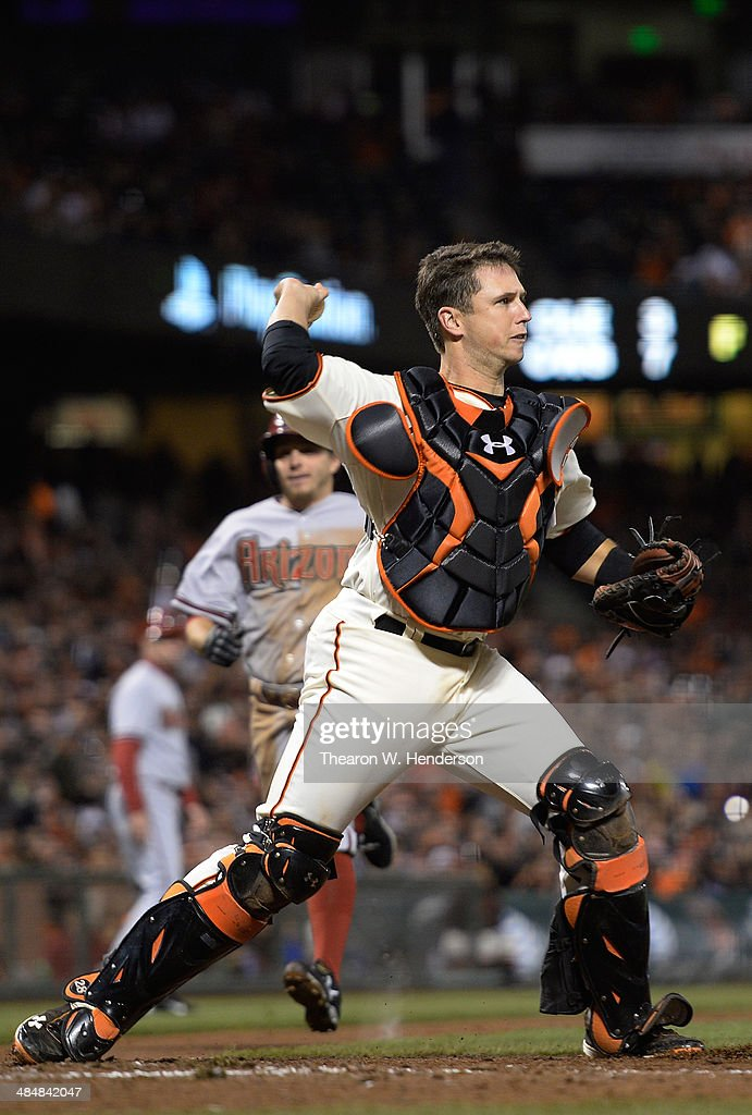Buster Posey #28 of the San Francisco Giants throws to first base to complete 1-2-3 double-play against the Arizona Diamondbacks in the top of the seventh inning at AT&T Park on April 10, 2014 in San Francisco, California.