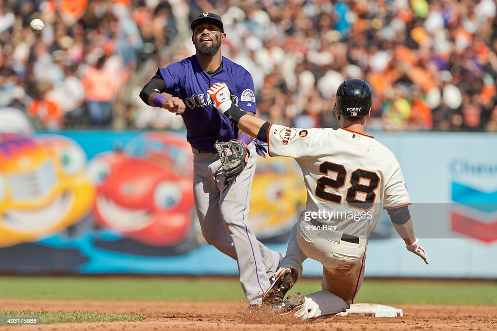 <a gi-track='captionPersonalityLinkClicked' href=/galleries/search?phrase=Buster+Posey&family=editorial&specificpeople=4896435 ng-click='$event.stopPropagation()'>Buster Posey</a> #28 of the San Francisco Giants tries unsuccessfully to break up a double play against shortstop <a gi-track='captionPersonalityLinkClicked' href=/galleries/search?phrase=Jose+Reyes+-+Baseball+Player&family=editorial&specificpeople=203307 ng-click='$event.stopPropagation()'>Jose Reyes</a> #7 of the Colorado Rockies in the third inning at AT&T Park on October 4, 2015 in San Francisco, California, during the final day of the regular season. The Rockies won 7-3.
