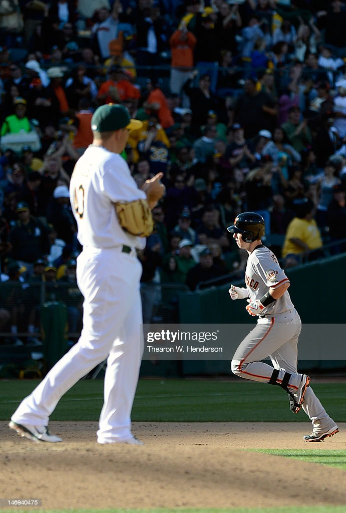 <a gi-track='captionPersonalityLinkClicked' href=/galleries/search?phrase=Buster+Posey&family=editorial&specificpeople=4896435 ng-click='$event.stopPropagation()'>Buster Posey</a> #28 of the San Francisco Giants trots around the bases after hitting a two-run home run as pitcher <a gi-track='captionPersonalityLinkClicked' href=/galleries/search?phrase=Brian+Fuentes&family=editorial&specificpeople=234863 ng-click='$event.stopPropagation()'>Brian Fuentes</a> #40 of the Oakland Athletics rubs up a new baseball in the seventh inning at O.co Coliseum on June 23, 2012 in Oakland, California.