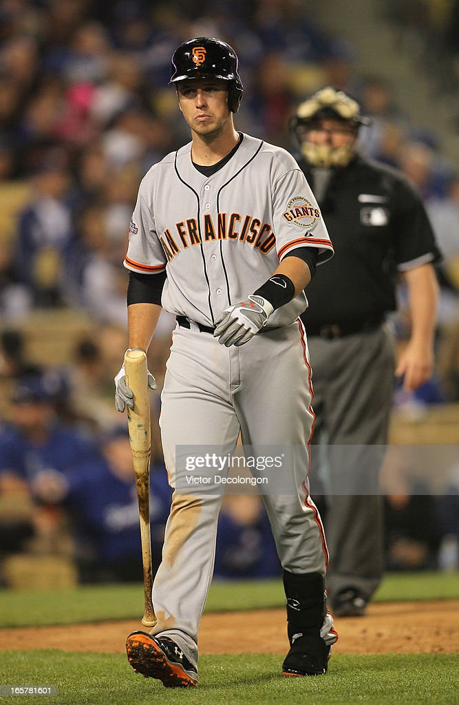 Buster Posey #28 of the San Francisco Giants walks back to the dugout after striking out in the sixth inning during the MLB game against the Los Angeles Dodgers at Dodger Stadium on April 3, 2013 in Los Angeles, California. The Giants defeated the Dodgers 5-3.