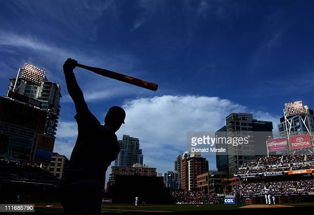Buster Posey of the San Francisco Giants warms up in the on deck circle against the San Diego Padres during their MLB Game at Petco Park on April 5...