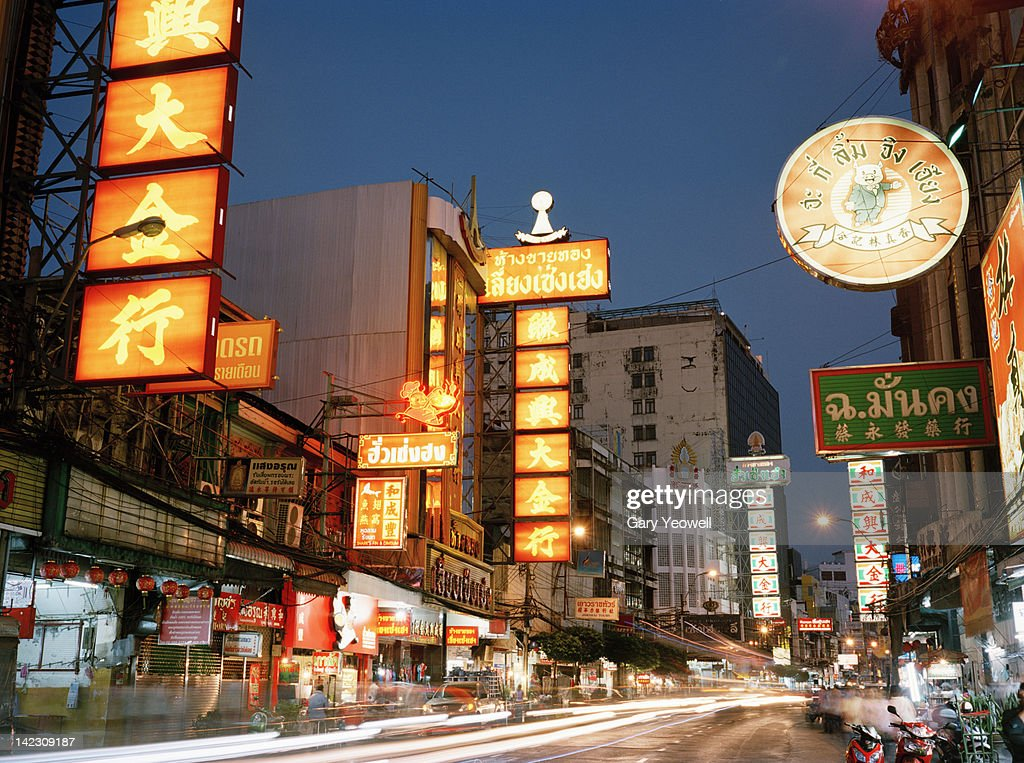 Bustling street in Chinatown at dusk : Stock Photo