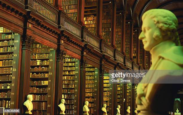 Busts and books in longroom of Old Library of Trinity College.