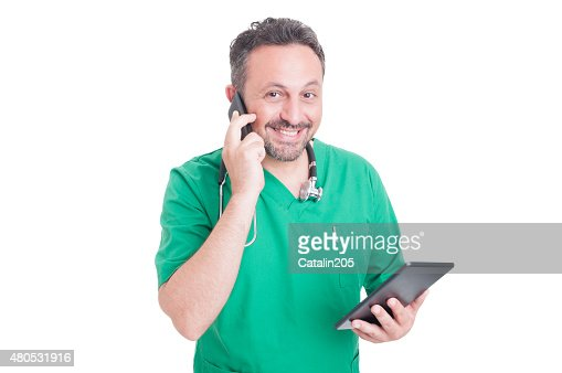 Busy and modern doctor multitasking : Stock Photo