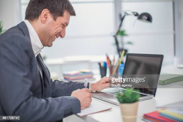 Busy businessman in office