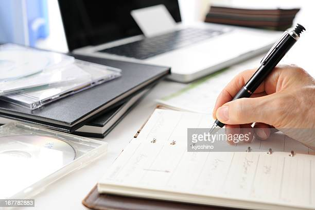 Busy businessman's writing a schedule